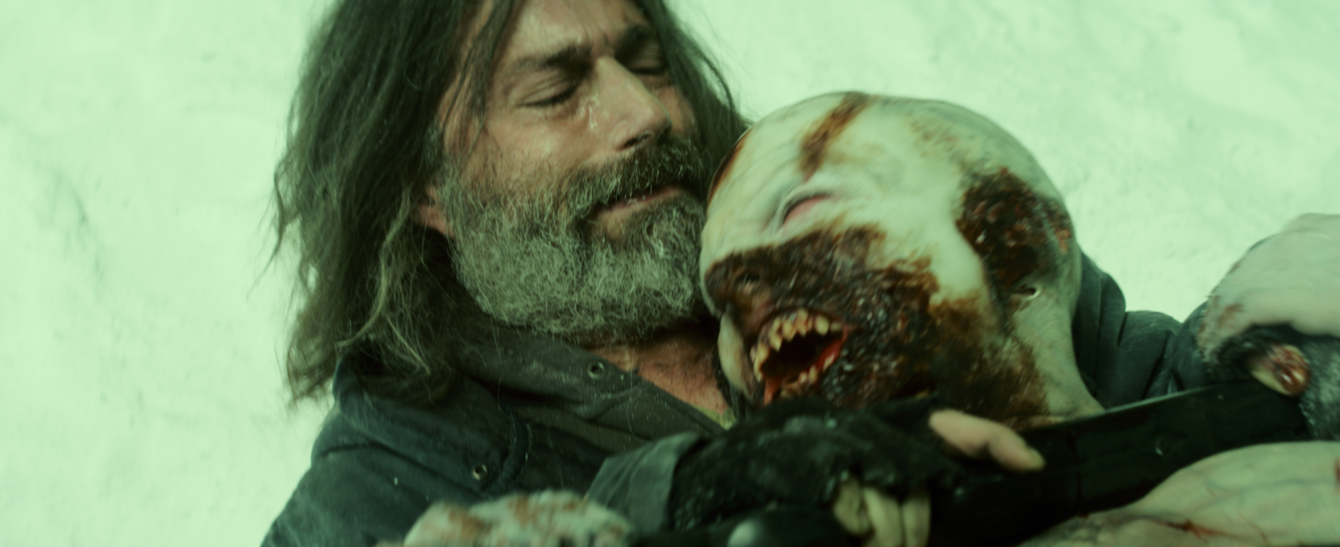 EXTINCTION-still4-Patrick-Matthew-Fox-tangles-with-zombie-courtesy-Vertical-Entertainment